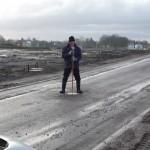 Einmessung des Gullideckels auf der Straße