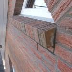 Haus nun mit Sohlbänken (Dreiecksfenster Osteite)